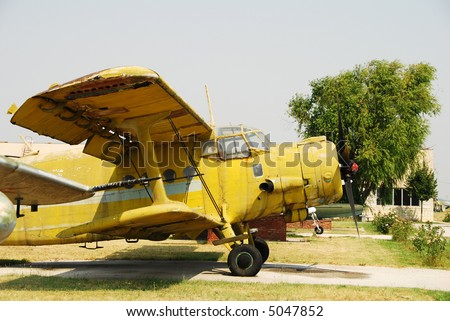 CLassic yellow colored biplane An-2