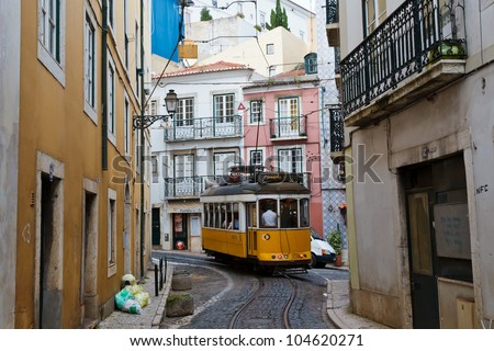 Classic Yellow Tram in Alfama quater in Lisbon, Portugal - stock photo