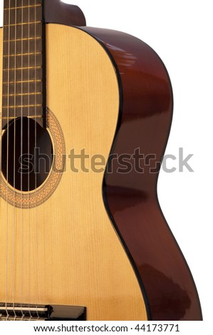 Classical acoustic guitar, isolated on grey background.