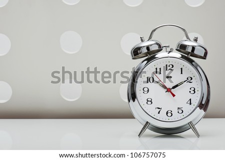 classical alarm clock on vintage background