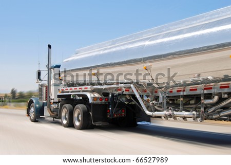Classical american big vintage petrol truck in motion - stock photo