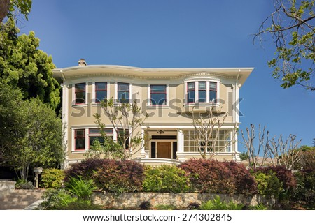 Classical American colonial revival home with blue sky. - stock photo