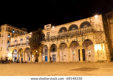 Classical ancient colonial building in Havana illuminated at night - stock photo