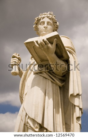 Classical antic greek statue of woman with the book - stock photo