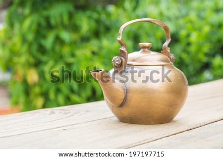 Classical asian teapot at outdoors - stock photo