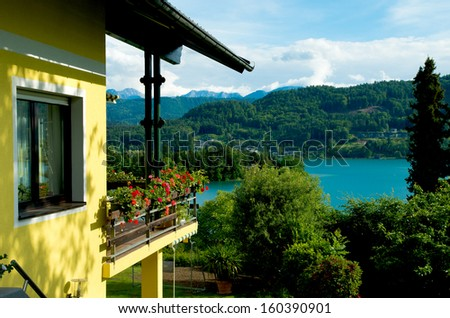 classical austrian house with view over the worther see - stock photo