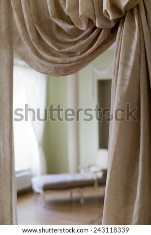 Classical bedroom interior with sand color curtains - stock photo