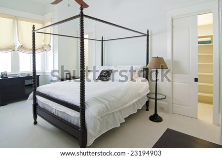 classical bedroom with four poster bed - stock photo