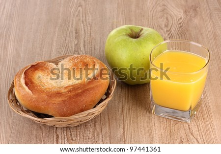 Classical breakfast. Orange juice and bun