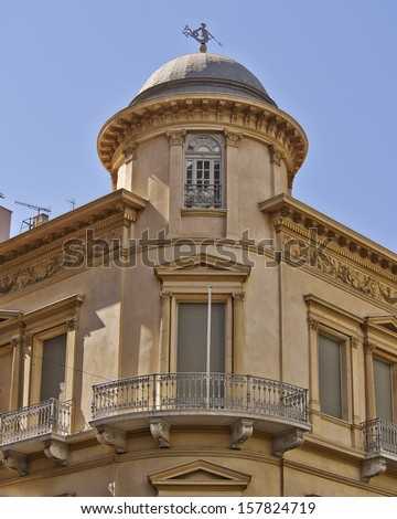 classical building dome with Triton ancient Greek deity as wind vane, Athens - stock photo