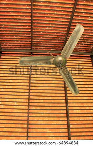 Classical ceiling fan with a background of orange baked clay tiles in Thailand - stock photo