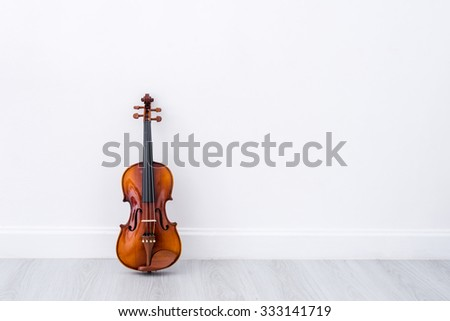 Classical cello on white wall background - stock photo