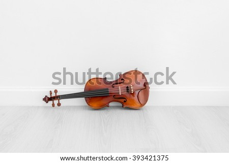 Classical cello on white wall background with copy space. - stock photo