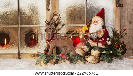 Classical christmas decoration: santa claus riding on reindeer buying gifts. - stock photo