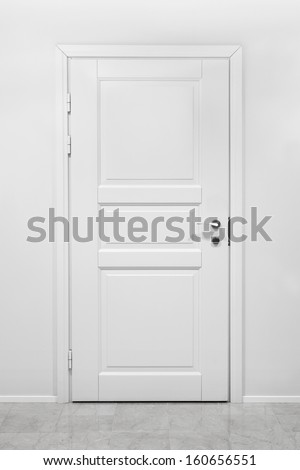 Classical closed wooden door in white office wall - stock photo
