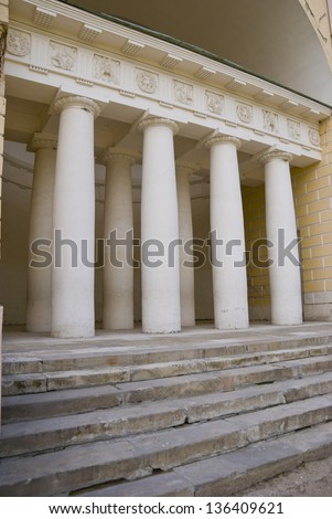 Classical colonnade in antique style white stone with a portico