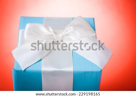 classical gift box  over red background - stock photo