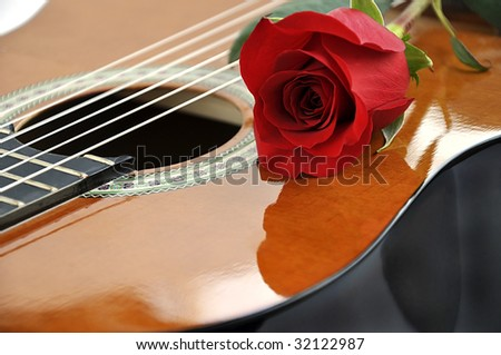 Classical guitar and rose. Theme of love and art. - stock photo