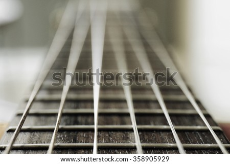 Classical Guitar fretboard blurring in the distance - stock photo