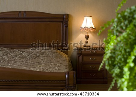 Classical interior of a bedroom. Fern.