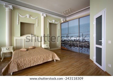 Classical interior of a bedroom with a bed - stock photo