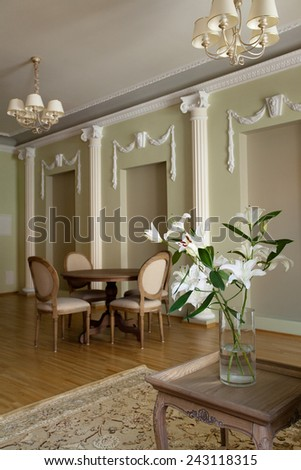 Classical interior of a living room with dining table and chairs - stock photo