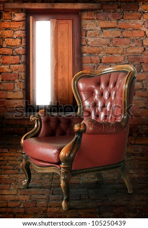 Classical leather armchair in old bricks room, computer graphic
