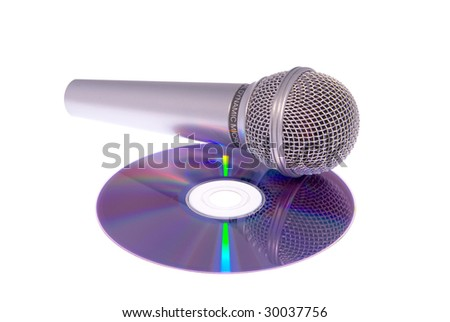 classical metal microphone on CD - stock photo