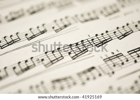 Classical music - notes on vintage sheet (shallow DOF) - stock photo