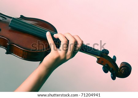 classical music Violin is in the hands of professional violinist. Details of violin playing close-up. - stock photo