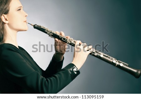 Classical musician oboe playing. Oboist with musical instrument
