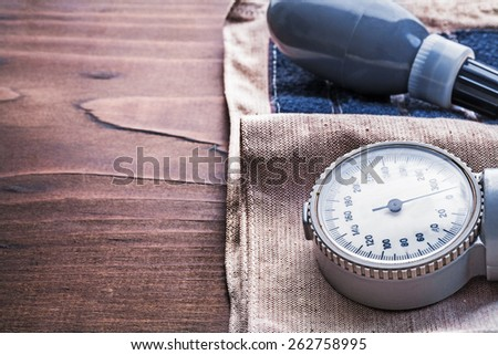 classical old fashioned stethoscope on vinatge wooden board medical concept  - stock photo