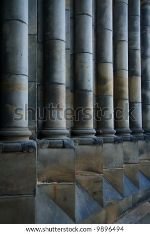 Classical Old Grey Pillars in Perspective - stock photo