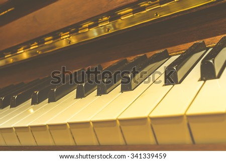 Classical piano keys in warm color tone , process in vintage style - stock photo