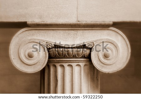 Classical pillar detail  in sepia - stock photo