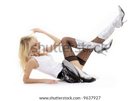 classical pin-up image of laying blonde in silver boots - stock photo