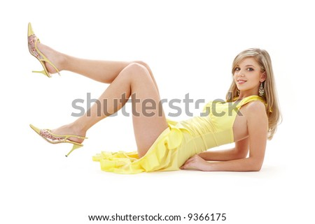 classical pin-up image of pretty lady in yellow dress over white - stock photo