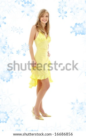 classical pin-up image of pretty lady in yellow dress with snowflakes - stock photo