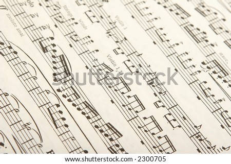 classical sheet music for woodwind and string instruments - stock photo
