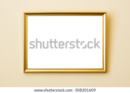 Classical simple golden frame on a beige wall with drop shadow - stock photo