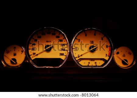 Classical sport dashboard, includes speedometer, tachometer, fuel, and temperature controls with chromed rings. Lights, oil pressure and battery are turned off. you can see sunlight at dusk reflect - stock photo