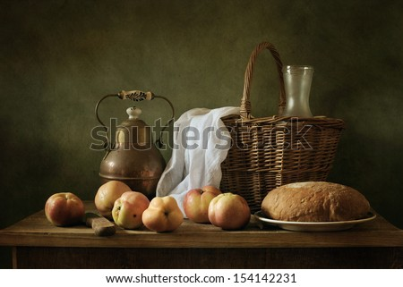 Classical still life wth apples and bread - stock photo