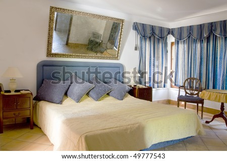 Classical style and elegant decorated sleeping room (bedroom) with a big mirror - stock photo