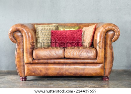 classical style Armchair sofa couch in vintage room with desk lamp - stock photo