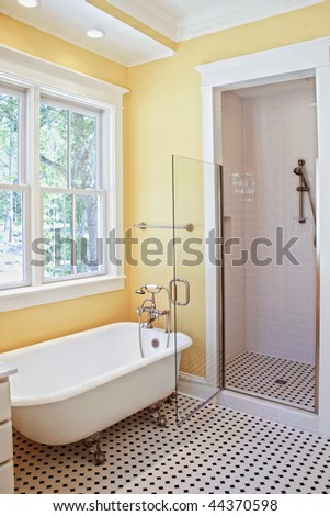 classical style bathroom with clawfoot tub and shower - stock photo