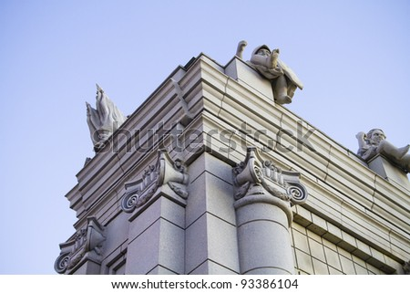 Classical style columns in ionic order on exterior of modern building. - stock photo