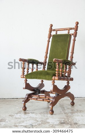 Classical style rocking chair with green wool  in vintage room - stock photo