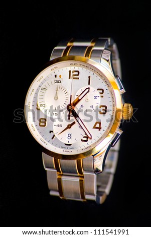 Classical swiss watch with chronograph on a black background - stock photo