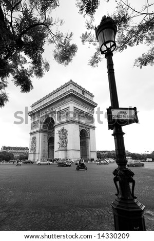 Classical view of the Arc de Triomphe in Paris, France. - stock photo