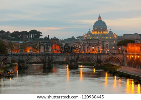 Classical view on Vatican over the Tiber river at early evening - stock photo